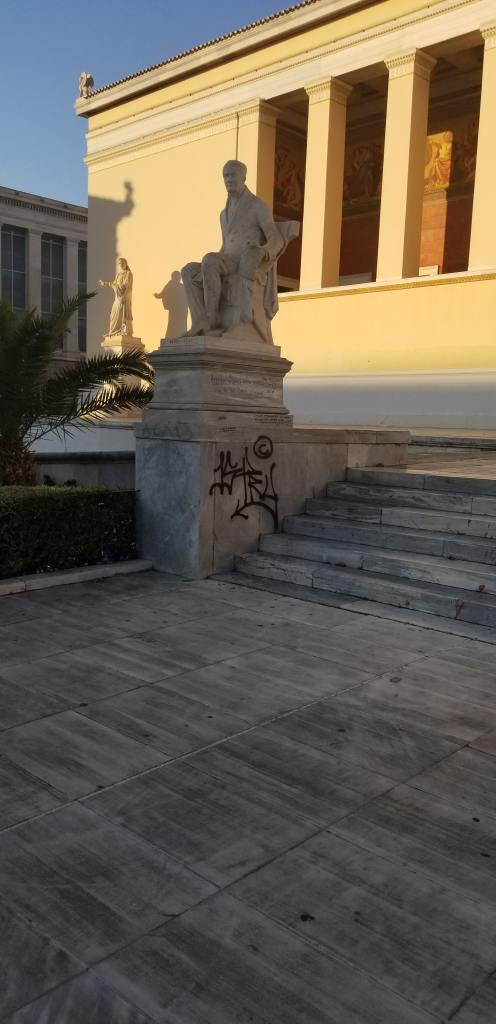 Graffiti on a national monument in Athens, Greece.
